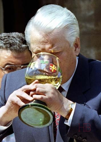Russian President Boris Yeltsin drinks white wine from German Chancellor Helmut Kohl